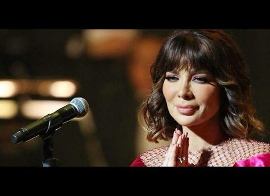 صور..عملية تجميل فاشلة تشوه وجه أصالة وتمزق فستانها على المسرح بالكويت
